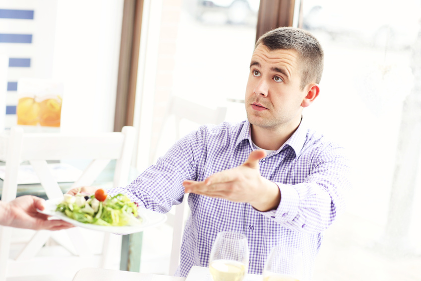 A picture of a customer coplaining about the food in a restaurant